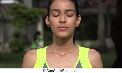 Fit Teen Girl Quietly Meditating