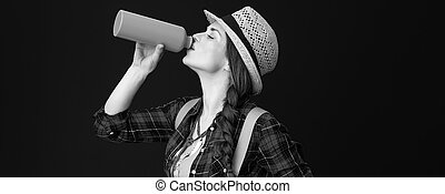 fit tourist woman isolated on background drinking water