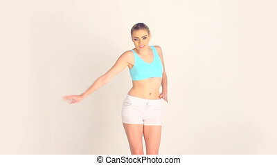 fit woman dancing in the studio