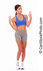 Fit woman full length against white background