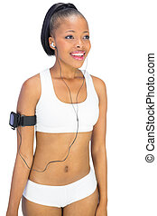 Fit woman in sportswear listening to music