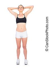 Fit woman in sportswear relaxing