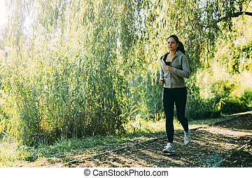 Fit woman jogging outdoors