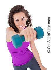 Fit woman lifting blue dumbbell