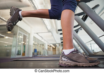 Fit woman running on the treadmill