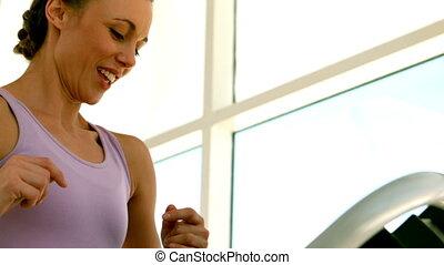 Fit woman running on treadmill