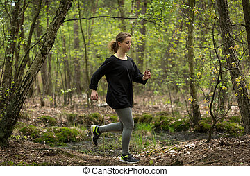 Fit woman running outdoors