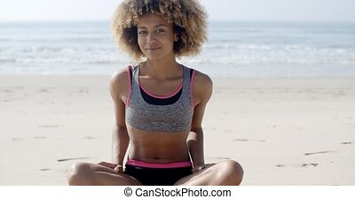 Fit Woman Sits On The Beach