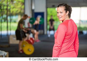 Fit Woman Smiling At Box
