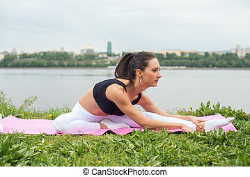 Fit woman stretching legs and back street training, fitness, sport