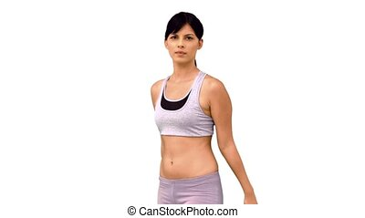 Fit woman striking a karate pose on white background in slow...