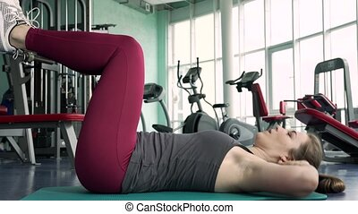Fit Woman Training Abdominal And Core Muscles at the Gym....