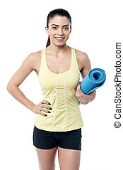 Fit woman with a gym mat
