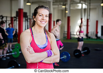 Fit Woman With Arms Crossed Standing In Fitness Center -...