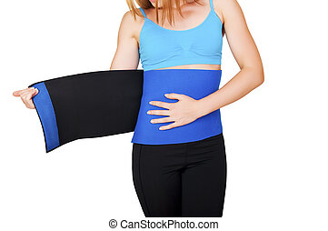 Fit woman with belt for weight loss isolated over white background