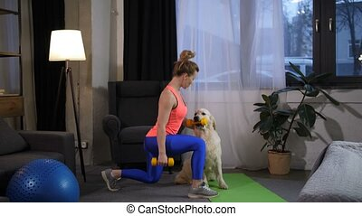 Fit woman with dog doing lunge excercise at home - Healthy...
