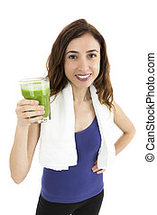 Fit woman with green smoothie
