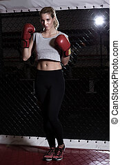 Fit woman with red boxing gloves