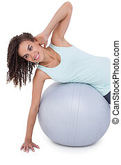 Fit woman wokring out on exercise ball