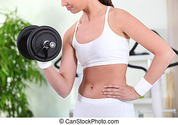 Fit woman working out with weights