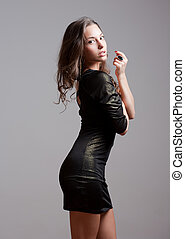 Fit young beauty in sequin dress. - Sensual portrait of a...