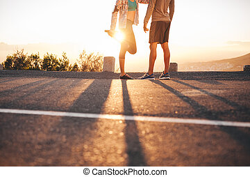 Fit young couple warming up before a run