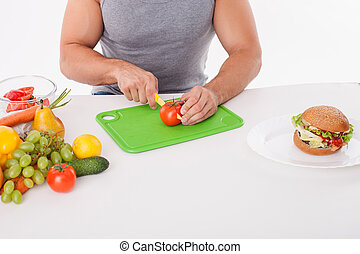 Fit young man is preparing healthy food