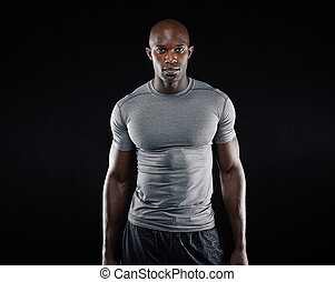 Fit young man with muscular build - Portrait of fit young...