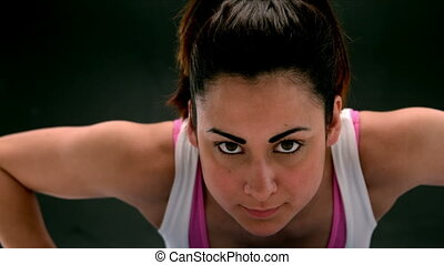 Fit young woman doing a push up
