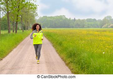 Fit young woman enjoying her morning run