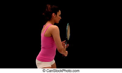 Fit young woman playing tennis in slow motion