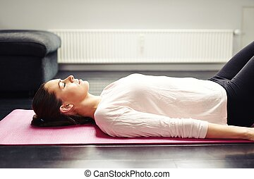 Fit young woman relaxing on yoga mat - Image of fit young...