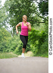 Fit young woman running in the park