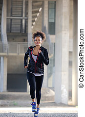 Fit young woman running outdoors