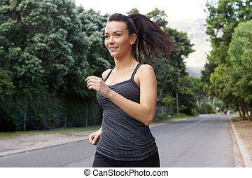 Fit young woman running outside