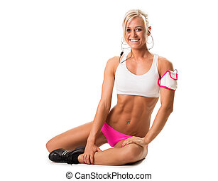 Fit young woman training physically at the gym. Isolated white background