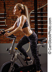 Fit young woman working out in the exercise machine