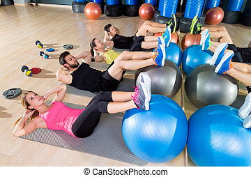 Fitball crunch training group core fitness at gym abdominal...