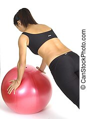 Female fitness instructor demontrates a pash-up on a fitness ball