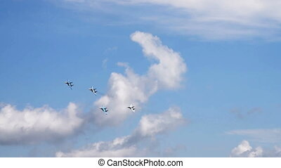 Fither planes in blue sky
