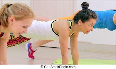 Fitness. Aerobics on the floor