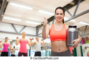 teenage girl with jar of protein showing thumbs up
