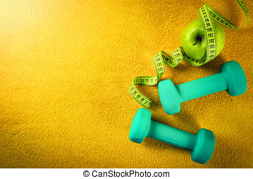fitness and healthy nutrition concept on yellow background. top view copy space