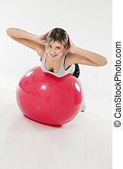 fitness and yoga - front view of woman exercising on fitness...