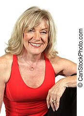 Fitness At Fifty - A beautiful, fit fifty year old woman in...