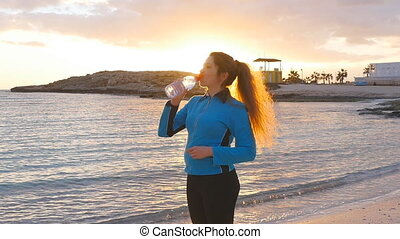 Fitness athlete woman drinking water