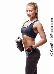 Fitness - Athletic girl with a shaker on white background