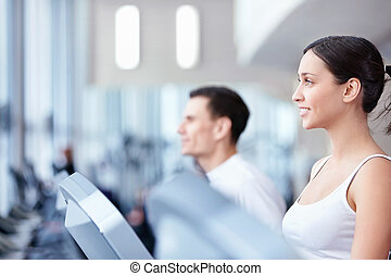 Attractive young people engaged in fitness