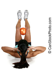 Fitness Ball - Woman doing crunches with fitness ball over...