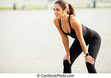Fitness. Beautiful young woman doing exercises in the park